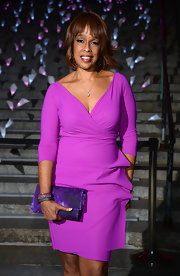 Gayle King stunned in a vibrant purple frock with three-quarter-length sleeves.
