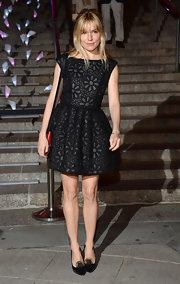 Sienna Miller chose this floral LBD for her mod-inspired evening look.