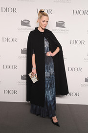 Jaime King completed her ensemble with a printed box clutch by Dior.