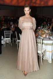 Karlie Kloss was demure in a pale pink ball gown by Dior Couture at the Guggenheim International Gala Dinner.