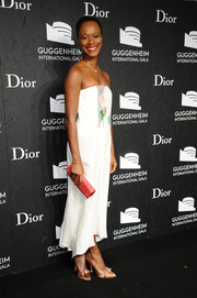 Shala Monroque added a bright pop with a pink leather clutch.