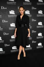 Leelee Sobieski was the picture of classic elegance in a belted black coat dress by Dior during the Guggenheim International Gala.