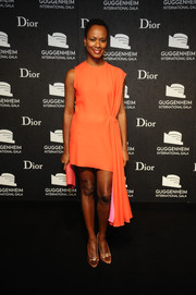 Shala Monroque donned an orange Dior cocktail dress with draped detailing for the Guggenheim International Gala.
