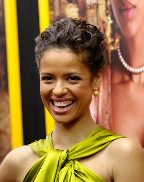 Gugu Mbatha-Raw Dangling Spheres [hair,facial expression,smile,hairstyle,yellow,beauty,black hair,happy,belle,gugu mbatha-raw,new york,the paris theatre,premiere,premiere]
