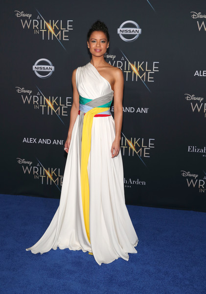 Gugu Mbatha-Raw One Shoulder Dress [a wrinkle in time,yellow,flooring,shoulder,joint,gown,fashion model,dress,carpet,fashion,red carpet,arrivals,gugu mbatha-raw,california,los angeles,el capitan theatre,disney,premiere,premiere]