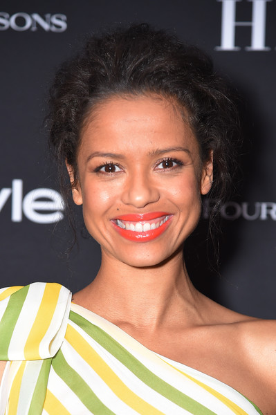 Gugu Mbatha-Raw Messy Updo [hair,face,hairstyle,eyebrow,lip,beauty,skin,smile,chin,black hair,arrivals,gugu mbatha-raw,four seasons hotel,toronto,canada,hollywood foreign press association and instyle party,the hollywood foreign press association,toronto international film festival]