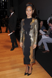 Jada Pinkett Smith stepped out for the Guy Laroche fashion show wearing a futuristic-chic black and gold knit dress from the brand.