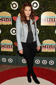 Michelle Monaghan layered a pale blue leather jacket over her all black look at the launch of Harajuku Mini.