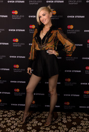 Gwen Stefani kept it classic up top in a long-sleeve print blouse while attending a MasterCard event.