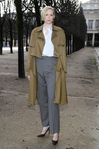 Gwendoline Christie High-Waisted Pants [clothing,street fashion,fashion,coat,outerwear,trench coat,snapshot,standing,brown,pantsuit,louis vuitton,gwendoline christie,front row,part,paris,france,paris fashion week,show,louis vuitton menswear fall]