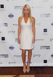 Tracy Anderson chose a classic halter dress with a pleated skirt for her look at the Licensing Expo in Las Vegas.