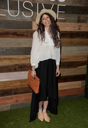 Pamela Love looked conservative in a long-sleeve loose white blouse during the H&M Conscious Collection dinner.