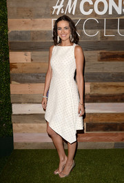 Camilla Belle paired her dress with lovely gold Christian Louboutin Toboggan sandals.