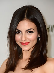 Victoria Justice strayed from the typical pink or red lip and chose this fun coral color for her look at an H&M event.