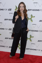 Olivia Wilde teamed her blazer with black wide-leg slacks for a masculine-chic finish.