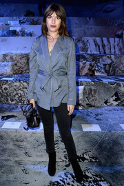 Jeanne Damas rocked a pajama-chic wrap top at the H&M fashion show.