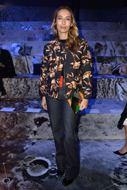 Alexandra Golovanoff attended the H&M fashion show all covered up in a floral zip-up jacket.