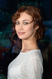 Olga Kurylenko sported a red carpet-worthy chignon when she attended the H&M fashion show.