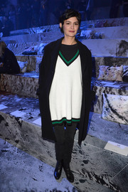 Audrey Tautou went the sporty route in a baggy white V-neck sweater with green and black piping when she attended the H&M fashion show.