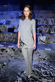 Marie-Ange Casta kept it laid-back in a ribbed gray knit top when she attended the H&M fashion show.
