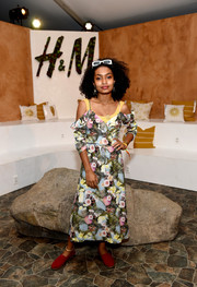Yara Shahidi embraced spring with this cold-shoulder floral wrap dress at the H&M Loves Coachella event.