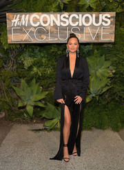 Chrissy Teigen worked a cleavage-baring black blazer by H&M Conscious during the brand's dinner.