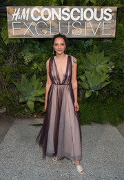 Sasha Lane hovered between sweet and sexy in a semi-sheer gown by H&M Conscious while attending the brand's dinner.