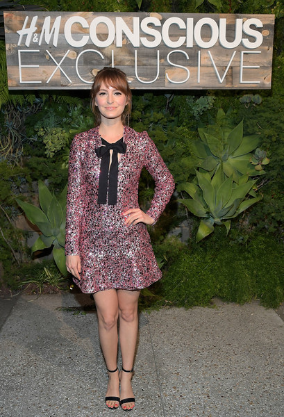 Ahna O'Reilly looked festive in a pink H&M Conscious sequin dress with black bow detailing while attending the brand's dinner.
