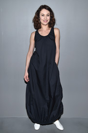 Olga Kurylenko was hard to miss in this black bubble-hem maxi dress by H&M during the brand's fashion show.