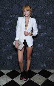 Bella Thorne paired a white blazer with short shorts for an oh-so-hot look during the H&M and Vogue Studios Between the Shows party.
