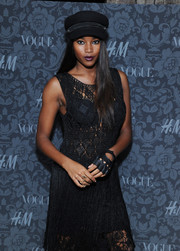 Damaris Lewis contrasted her girly dress with a tough-looking fingerless glove when she attended the H&M and Vogue Studios Between the Shows party.