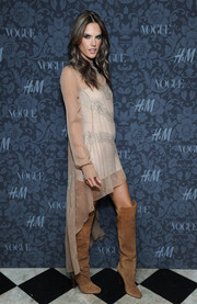Alessandra Ambrosio paired tan knee-high boots with her fab dress when she attended the H&M and Vogue Studios Between the Shows party.