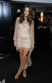 Alessandra Ambrosio looked downright sophisticated in a sheer, beaded fishtail dress at the H&M and Vogue Studios party.