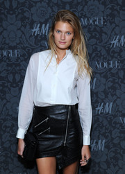 Constance Jablonski paired a classic white button-down with a black leather skirt for the H&M and Vogue Studios Between the Shows party.