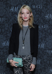 Cory Kennedy made her mixed-print shirt and pants combo chicer with a black cropped jacket when she attended the H&M and Vogue Studios Between the Shows party.