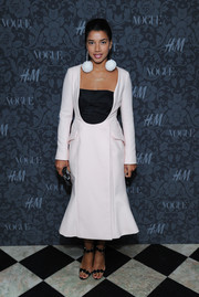 Hannah Bronfman turned heads with this modern black-and-white dress and pompom earrings combo at the H&M and Vogue Studios Between the Shows party.