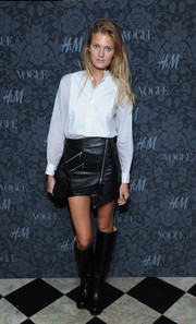 Constance Jablonski rocked a pair of black knee-high boots with her moto-chic mini skirt.