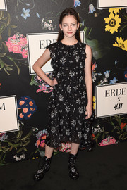 Mackenzie Foy kept it girly in a ruffled floral frock at the Erdem x H&M runway show.