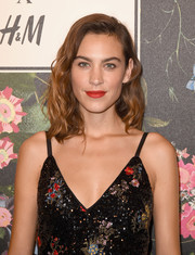 Alexa Chung looked pretty with her shoulder-length waves at the Erdem x H&M runway show.