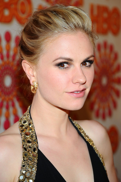 Anna Paquin's hair was drawn back in one-inch sections and pinned at the back of her head. The hair ends were then then twisted, looped and pinned. A good misting with a strong-hold hairspray completed the look.