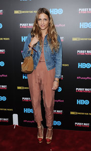 Charlotte Ronson paired a denim jacket over her jumpsuit for a cool and casual look.