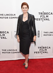 Debra Messing finished off her dress with a black leather blazer.
