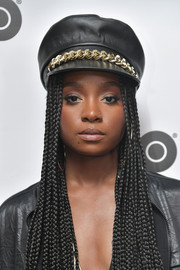 Kiki Layne attended the 'Native Son' dinner during Sundance 2019 wearing a chain-embellished captain's cap by Eugenia Kim.