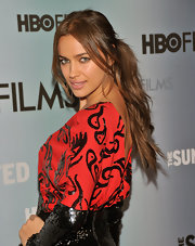Irina Shayk pulled her hair back in a sleek ponytail while allowing straight center part bangs to frame her face.