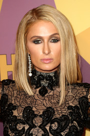 Paris Hilton opted for a loose straight side-parted style when she attended the HBO Golden Globes after-party.