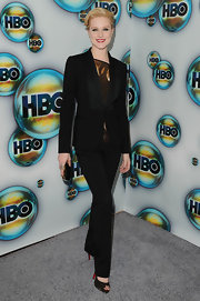 Evan Rachel Wood ditched her stunning gown for a well-tailored black suit at the HBO Golden Globe after party.