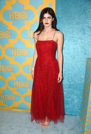 Alexandra Daddario was a fiery princess in a red spaghetti-strap Armani gown at the HBO Golden Globes party.
