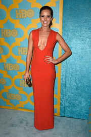 Katie Aselton wowed in a super low-cut red gown at the HBO Golden Globes party.