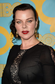 Debi Mazar styled her hair into a retro-glam side-swept updo for the HBO Golden Globes party.