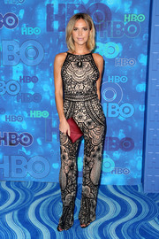Arielle Kebbel's burgundy satin envelope clutch added an elegant pop to her monochrome outfit.